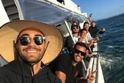 Shaun Johnson and Warriors' teammates were on a fishing trip yesterday when they were called on to help rescue a young man at Takapuna beach. Photo / Instagram