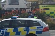 Police and ambulance staff attend the Taieri Mouth house where a man was arrested after an incident involving a machete in which another man was seriously injured. Photo / Stephen Jaquiery