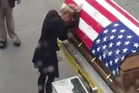 A heartbreaking video shared online shows the widow of fallen Green Beret Shawn Thomas, 35, meeting his coffin at Raleigh-Durham International Airport. Photo / Facebook
