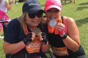 Vicki Walsh and best friend, Maree Morpeth with their medals from finishing the Wellington Round the Bays half marathon on Sunday. Photo / Facebook
