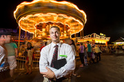 Indian Head Mayor Brandon Paulin hangs out on the boardwalk in Ocean City, Md., by tourist attractions at the Maryland Municipal League's annual conference. Photo for The Washington Post