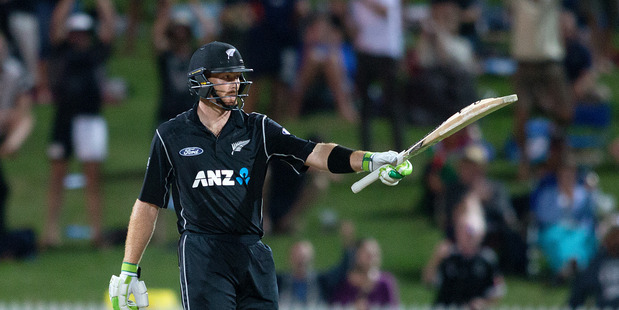 Loading Black Caps batsman Martin Guptill acknowledges the crowd after getting his 150 last night. Photo / Alan Gibson