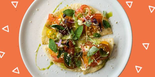 Tostada with heirloom tomato, jalapeno mayo, mint, basil,coriander and crushed almonds. Photo / Facebook, Azabu