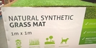 Oxymoronic grass mat spotted at Bunnings outlet in Hamilton. Photo / Supplied