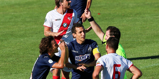 Auckland City's Albert Riera is shown a red card, one of three dished out on the day. Photo / Photosport