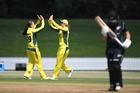 Meg Lanning takes a catch to dismiss Katey Martin as she celebrates with bowler Amanda-Jade Wellington. Photo / Photosport