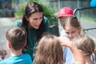 Mount Albert By-Election winner Jacinda Ardern (green dress) visits her electorate and home suburb of Point Chev for a Lion's Family day on Sunday. 26 February 2017. New Zealand Herald photograph by Nick Reed.