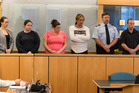 Michelle Blom, Nicola Jones, Julie-Ann Torrance, Cameron Hakeke and  Wayne Blackett appear in the Auckland High Court. The man second from right is a  court security guard. Photo / Brett Phibbs
