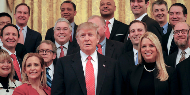 US President Donald Trump poses for a photo with the National Association of Attorneys General in the White House in Washington. Photo / AP