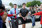 Austin Harrouff is transported by detectives to the Martin County Jail from St. Mary's Hospital in Florida. Photo / AP file