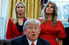Ivanka Trump, left, and first lady Melania Trump listen as President Donald Trump speaks in the Oval Office. Photo / AP