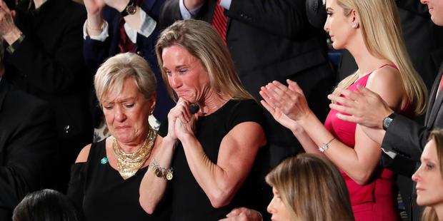 An emotional Carryn Owens, widow of widow of Chief Special Warfare Operator William ''Ryan'' Owens, on Capitol Hill in Washington. Photo/AP