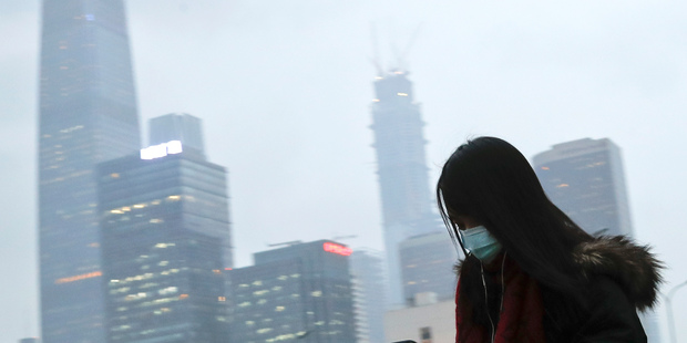 Readings in Beijing of air-polluting particles are on average seven times what the WHO recommends. Photo / AP