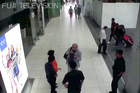 In this image made from footage from Kuala Lumpur airport security cameras obtained by Fuji TV, Kim Jong Nam talks to airport security and officials. Photo / AP