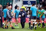 England's head coach Eddie Jones speaks to his players before the Six Nations match against Italy. Photo / AP