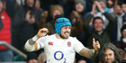 England's Jack Nowell celebrates as he scores a try. Photo / AP