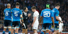 England's Owen Farrell speaks with referee Romain Poite during the Six Nations match against Italy. Photo / AP