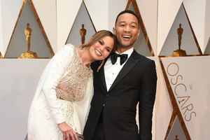 Chrissy Teigen, left, and John Legend arrive at the Oscars on Sunday, Feb. 26, 2017, at the Dolby Theatre in Los Angeles. (Photo by Jordan Strauss/Invision/AP)
