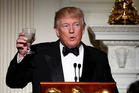 US President Donald Trump, makes a toast during a dinner reception for the annual National Governors Association winter meeting. Photo / AP