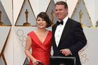 Martha L. Ruiz, left, and Brian Cullinan from PricewaterhouseCoopers arrive at the Oscars. Photo / AP