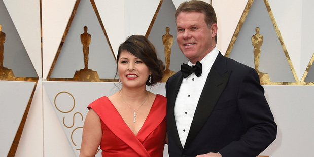 Loading Martha L. Ruiz, left, and Brian Cullinan from PricewaterhouseCoopers arrive at the Oscars. Photo / AP