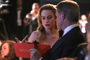 Brie Larson is handed the best actor envelope by accountant Brian Cullinan backstage at the Oscars at the Dolby Theatre in Los Angeles. Photo/AP