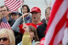 Backers of President Donald Trump gather at the Georgia Capitol in Atlanta, for a