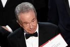 Best Picture presenter Warren Beatty reportedly wanted to prove to Moonlight director Barry Jenkins that the wrong announcement was not his fault. Photo / AP