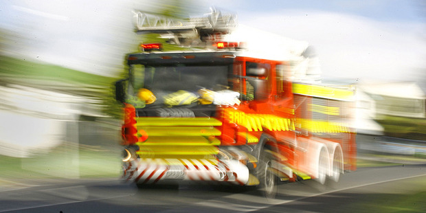 Three fire crews, four tankers and a digger are fighting a  bush blaze next to a rural road at Mayfield near Ashburton. Photo / File