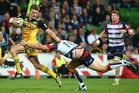 Beauden Barrett eludes the Rebels defence when the two teams played last season. Photo / Getty