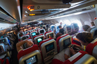 Stuck in economy class? It doesn't need to be a nightmare. Photo / Getty Images