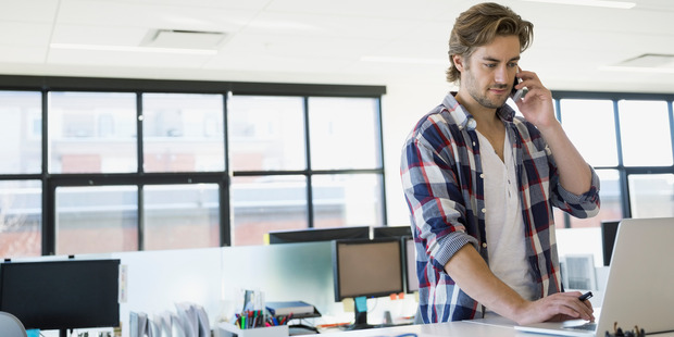 Standing desks may be part of the solution. Photo / Getty