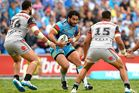 Konrad Hurrell of the Titans in action against the Warriors. Photo / Getty