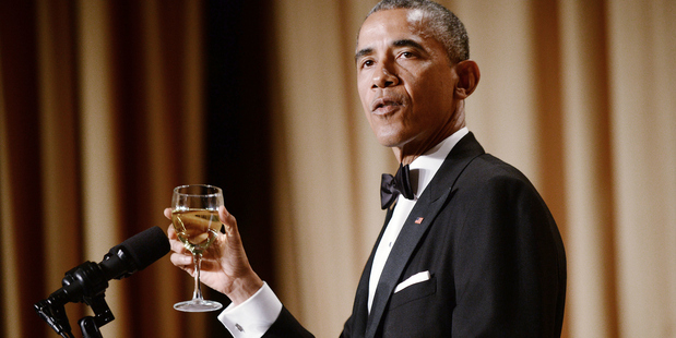 US President Barack Obama offers a toast at the annual White House Correspondent's Association Gala at the Washington Hilton hotel, 2015. Photo / Getty Images