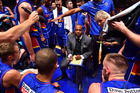 Joey Wright head coach of the Adelaide 36ers talks to his players during a time out. Photo / Getty Images
