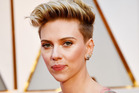 Actor Scarlett Johansson was not impressed with Ryan Seacrest's question on the red carpet at the Oscars. Photo / Getty