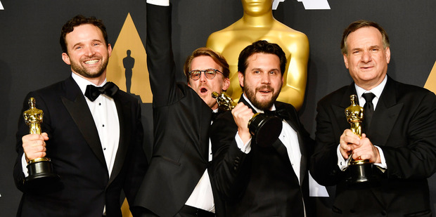 Visual effects artists Dan Lemmon, Andrew R Jones, Adam Valdez and Robert Legato celebrate their Oscars win for Best Visual Effects for The Jungle Book. Photo/Getty