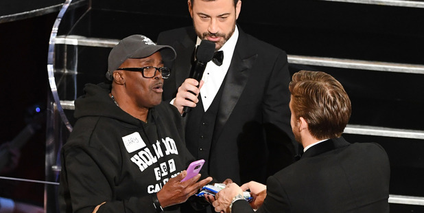 Host Jimmy Kimmel (C) and actor Ryan Gosling (R) surprises Gary (L) during the 89th Annual Academy Awards. Photo / Getty