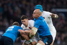 George Ford is tackled by Sergio Parisse (R) and Ornel Gega during England and Italy's Six Nations clash at Twickenham in London yesterday. Photo / Getty Images.