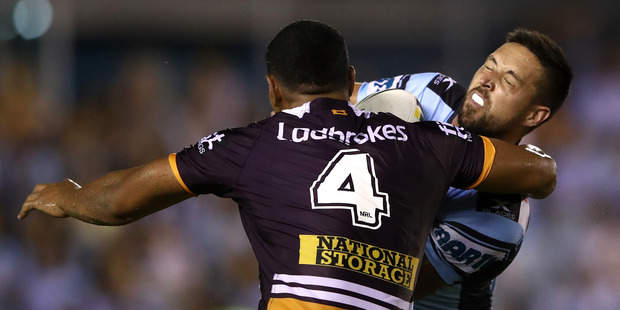 Gerard Beale of the Sharks is tackled during the NRL season opener. Photo / Getty
