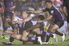 Josh Reynolds of the Bulldogs is tackled short of the line by Melbourne Storm players during Melbourne's 12-6 win in Sydney last night. Photo / Getty Images.