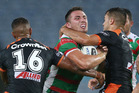Sam Burgess of the Rabbitohs is tackled by Luke Brooks of the Tigers and Michael Chee-Kam of the Tigers during the Tigers' 34-18 win in Sydney last night. Photo / Getty Images.