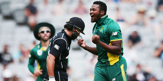 Andile Phehlukwayo of South Africa celebrates with teammates for the wicket of Dean Brownlie. Photo / Getty