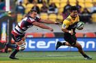Jake Schatz of the Melbourne Rebels misses the tackle on Ardie Savea of the Hurricanes. Photo / Getty
