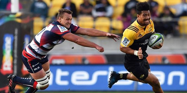 Loading Jake Schatz of the Melbourne Rebels misses the tackle on Ardie Savea of the Hurricanes. Photo / Getty
