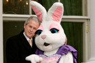 President George W. Bush embraces a person dressed as the Easter Bunny. Photo / Getty Images