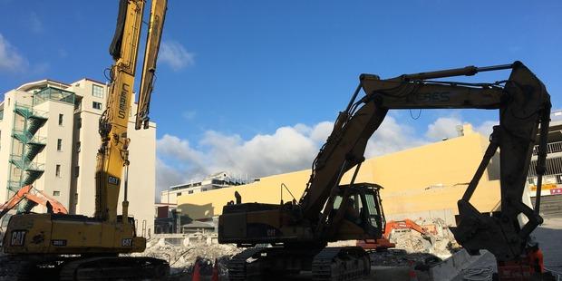 Four demolition machines stood tall against a crisp blue sky, ready to pounce. Photo/Georgina Campbell