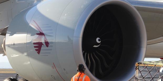 Loading The GE90 engines on a Qatar Airways Boeing 777-200LR. Photo / Grant Bradley.