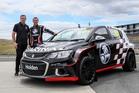 Greg Murphy and Josh Marston pose with the Holden Barina AP4 rally car. Photo / Simon Watts