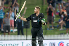 Martin Guptill acknowledges the crowd after getting his century - his 12th in one-day internationals. Photo / Alan Gibson
